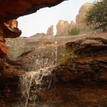 water falling into cave area in sedona red rocks