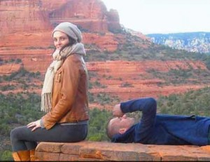 a couple sitting on red rocks on a sedona couples retreat