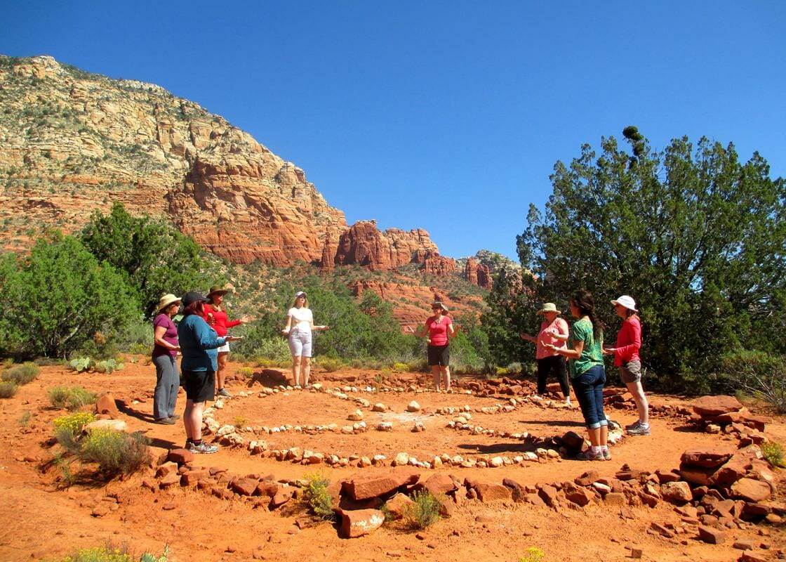 Shamanic journey retreat participants learn about the medicine wheel
