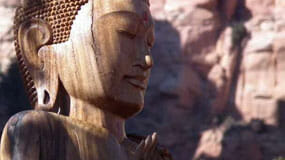 Statue of a buddha among Sedona's red rocks