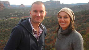 Smiling couple with view of red rocks on a Sedona Vortex couples retreat